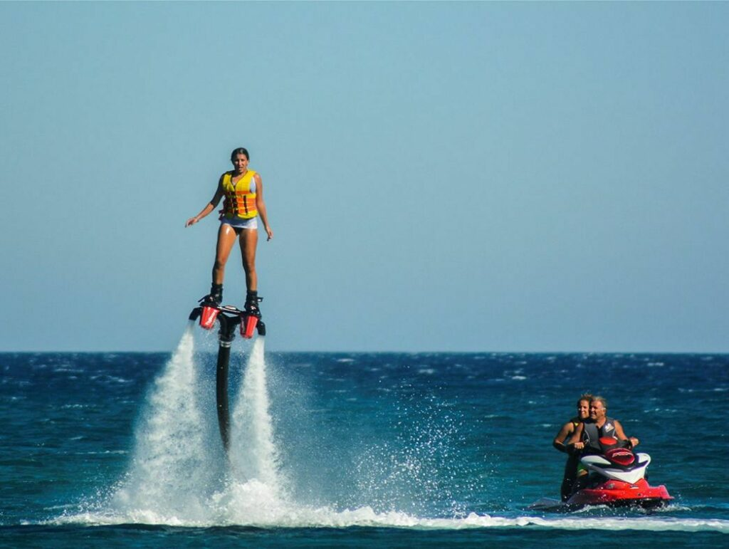Woman on fly board with jets in view